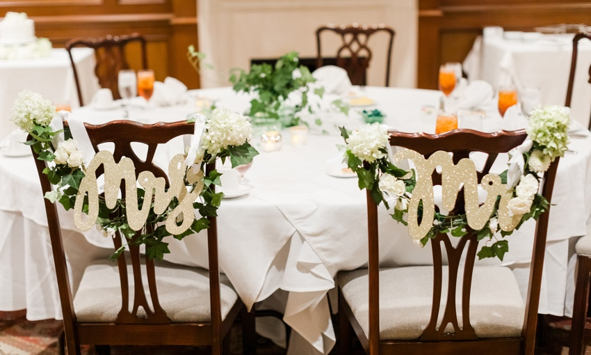 mr and mrs chairs set up for bride and groom dinner