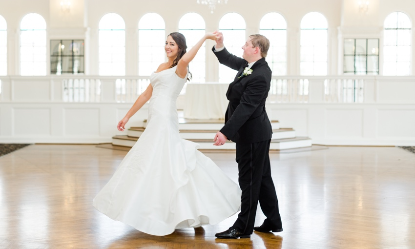 Bride and groom dance in ballroom at the florentine