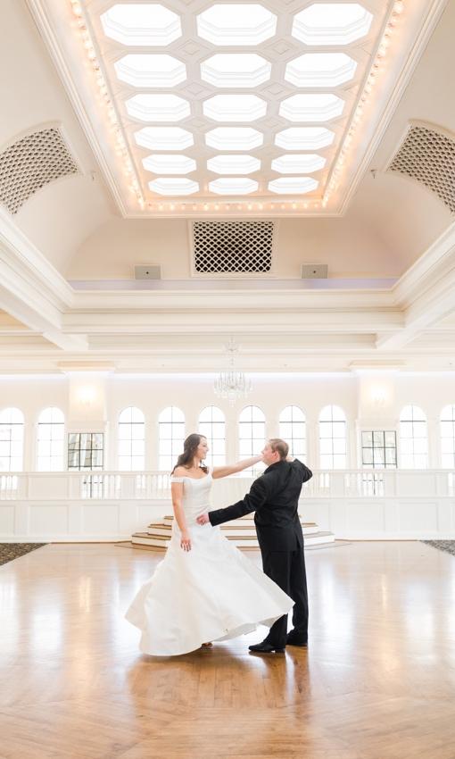 groom dipping bride in dance